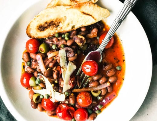 Puttanesca style beans and toast in a bowl