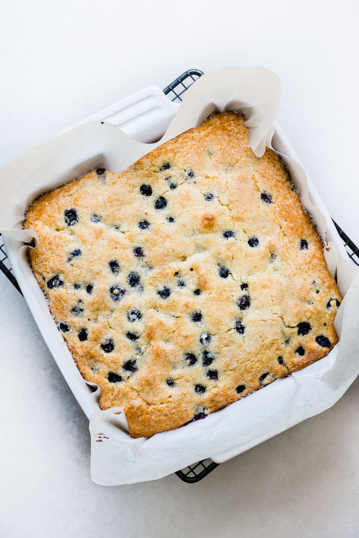 blueberry lemon breakfast cake in a baking pan