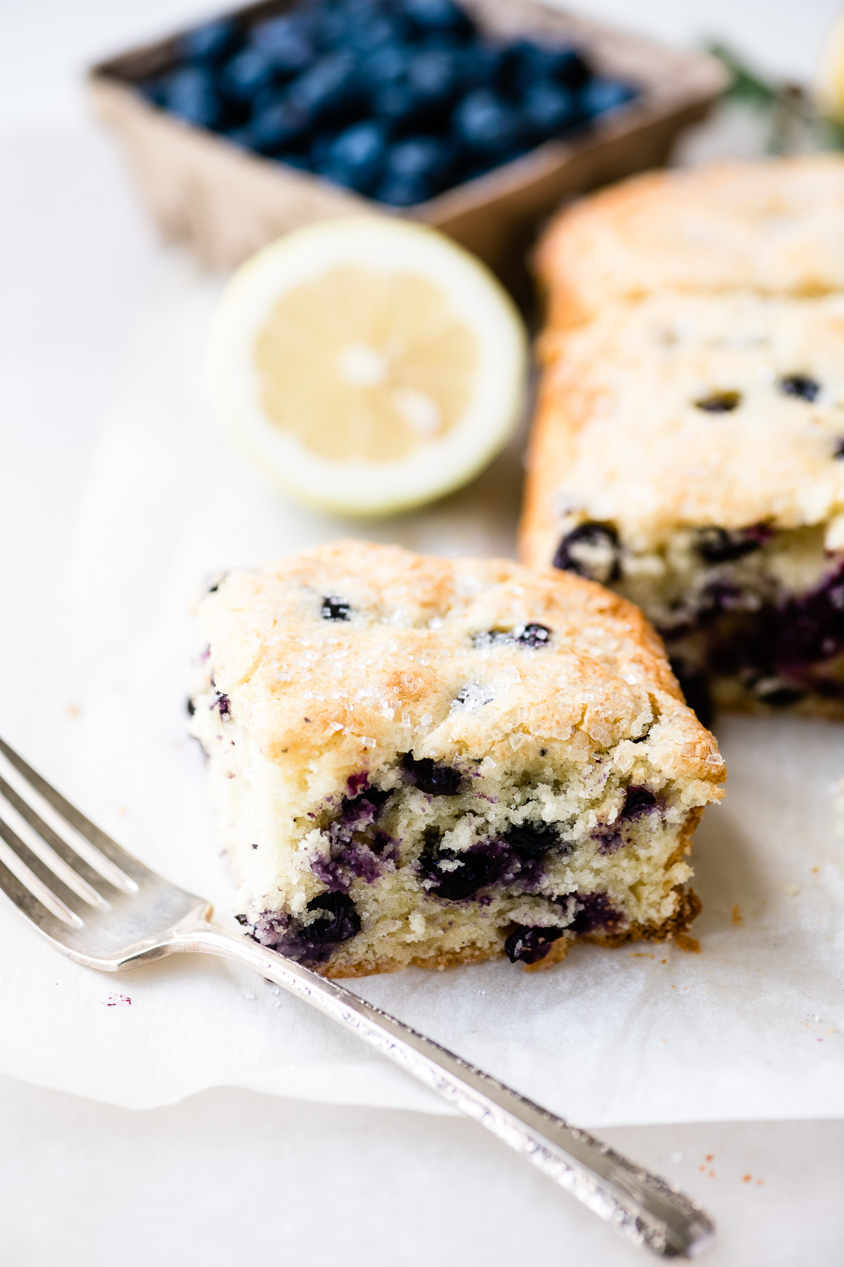a slice of blueberry lemon coffee cake