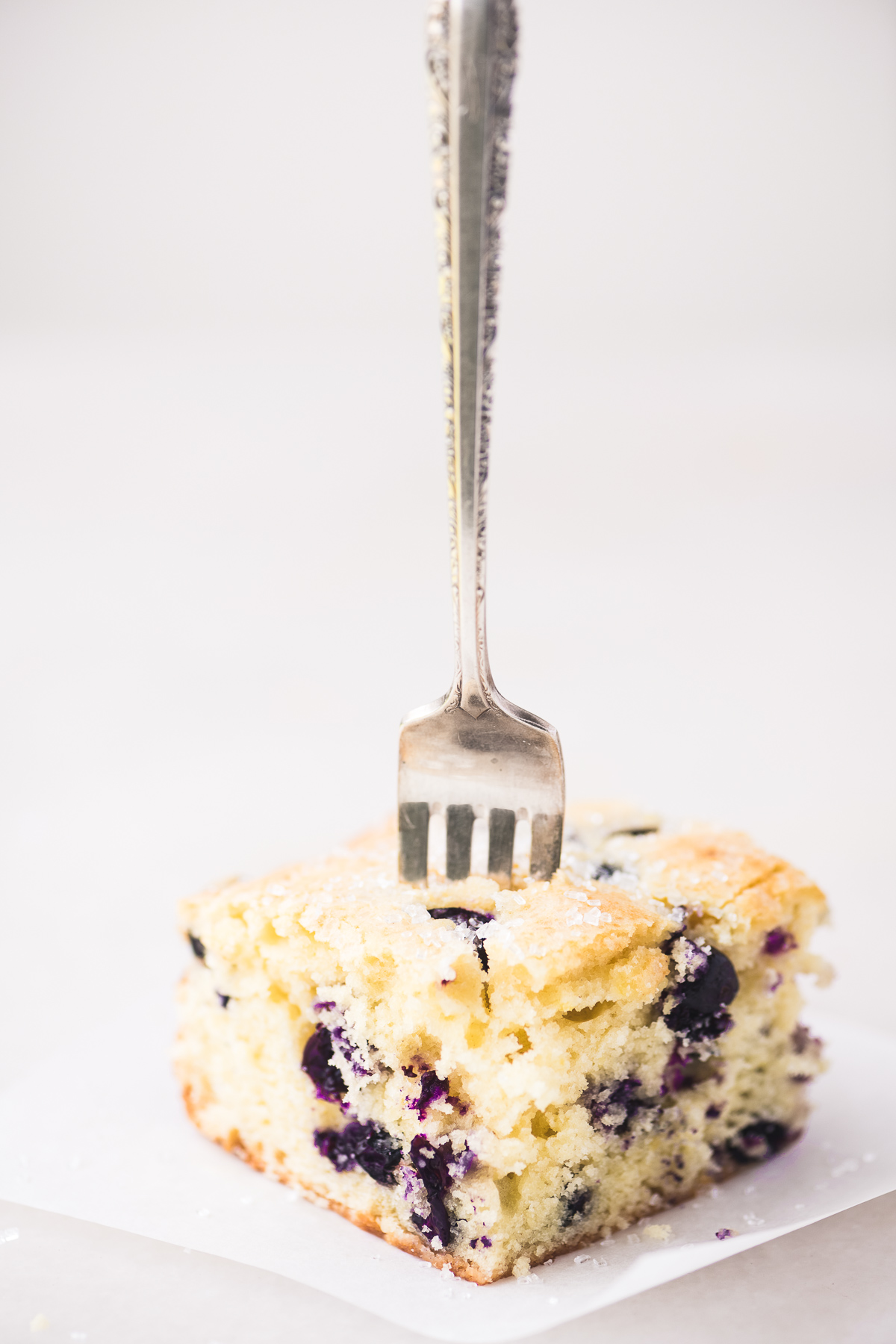 blueberry lemon coffee cake with a fork stuck in it