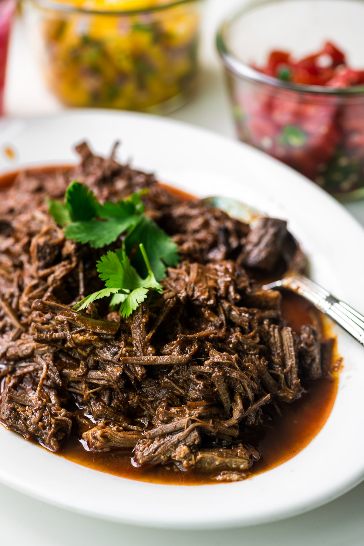 Instant Pot Barbacoa shredded beef on a platter