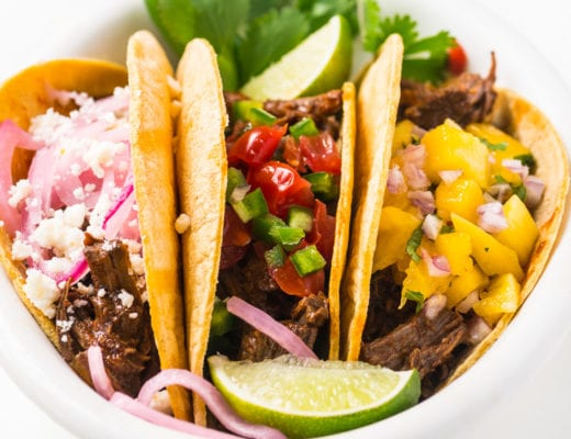 Instant Pot Barbacoa tacos in a white bowl
