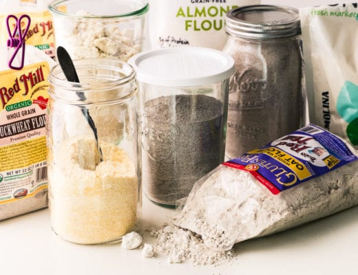 variety of flours in jars and bags