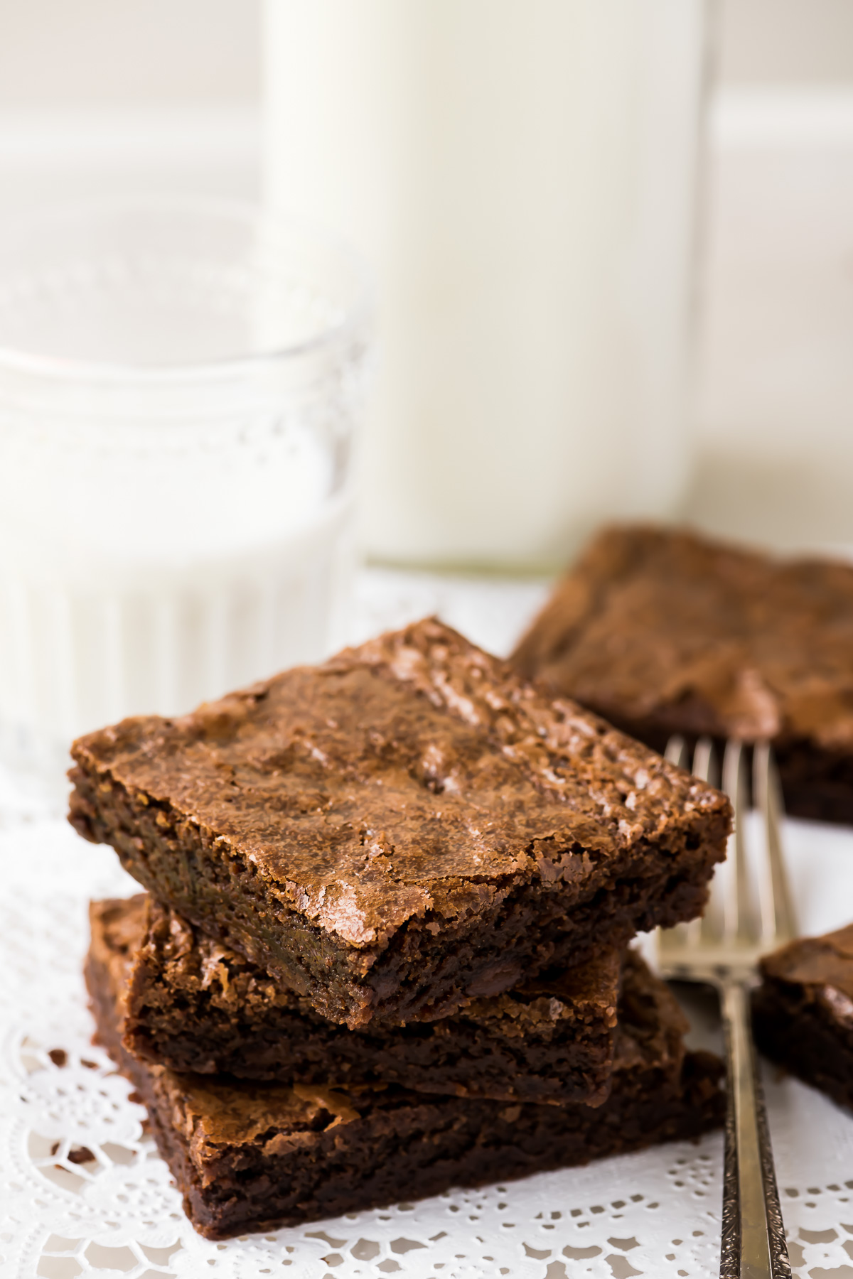 A stack of fudgy brownies with milk