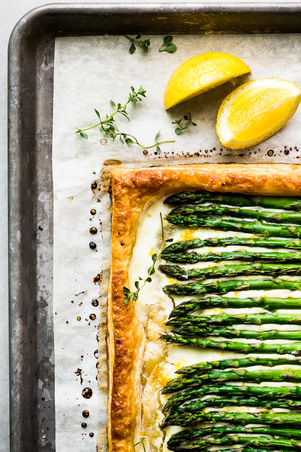 asparagus puff pastry tart on a baking sheet