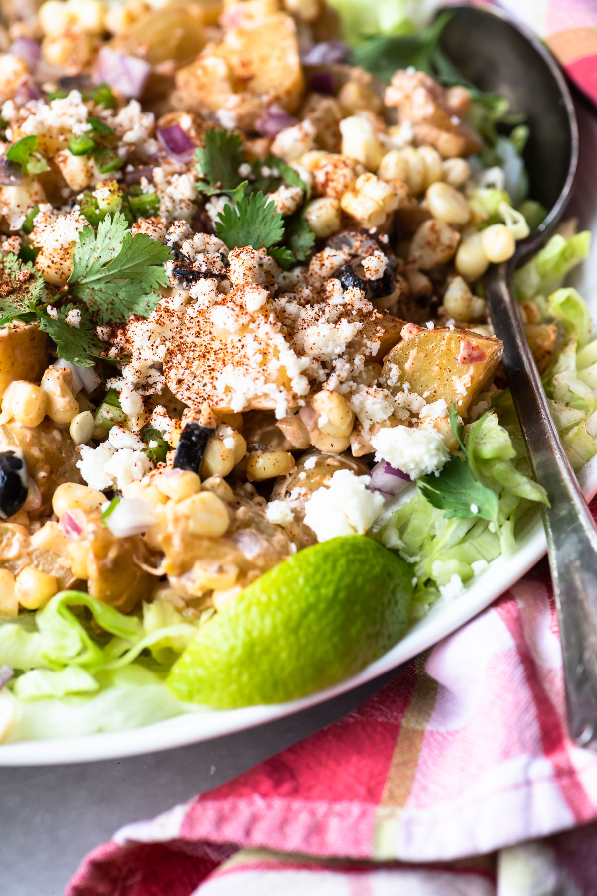 Mexican Street Corn Potato Salad with red plaid napkin