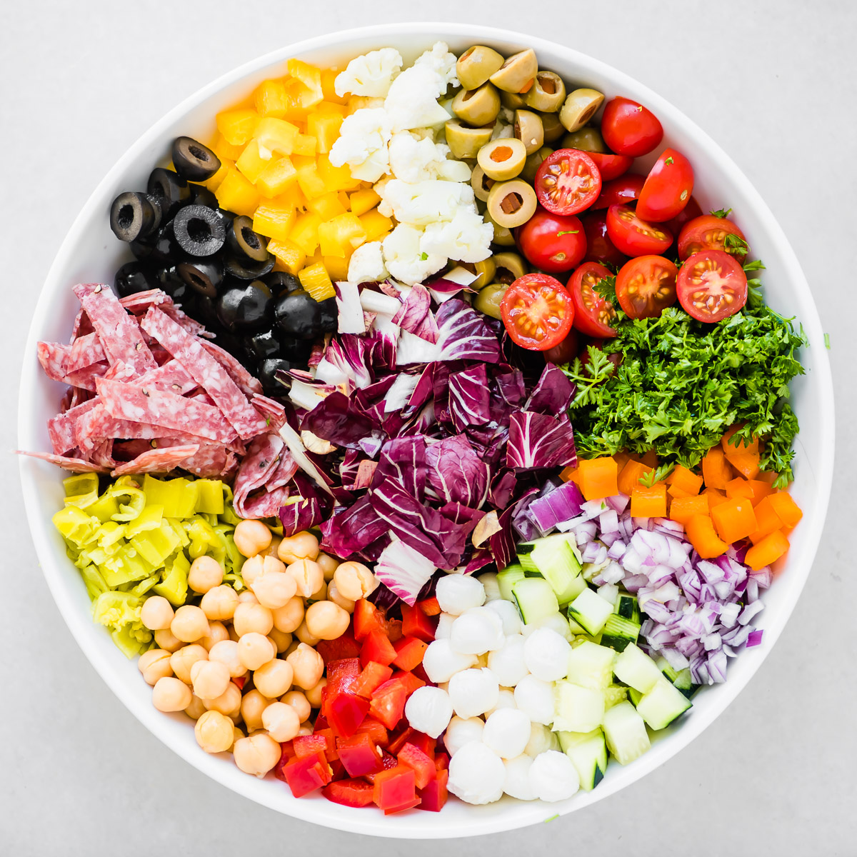 chopped Italian salad ingredients arranged in a salad bowl