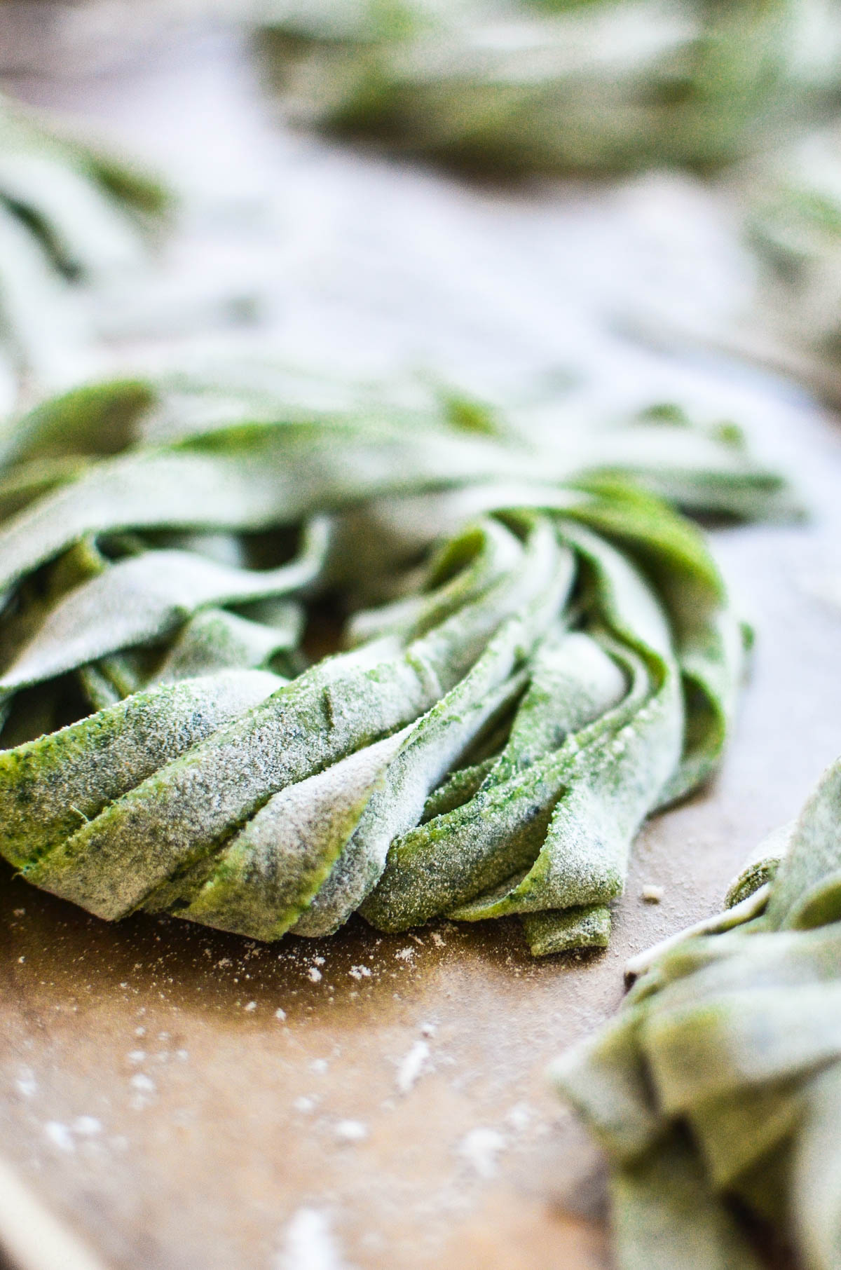 Homemade Pasta with Fresh Greens on a baking sheet.