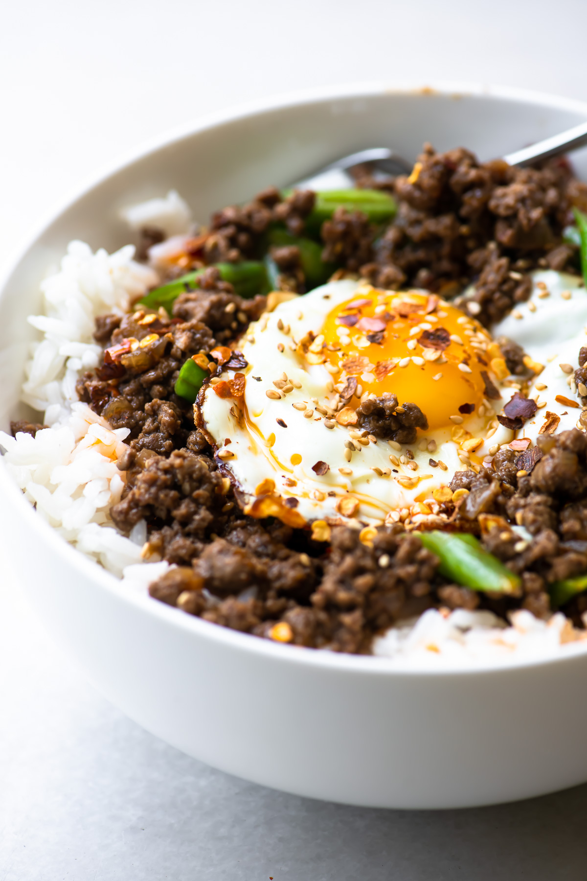 Korean beef and rice bowl with a fried egg