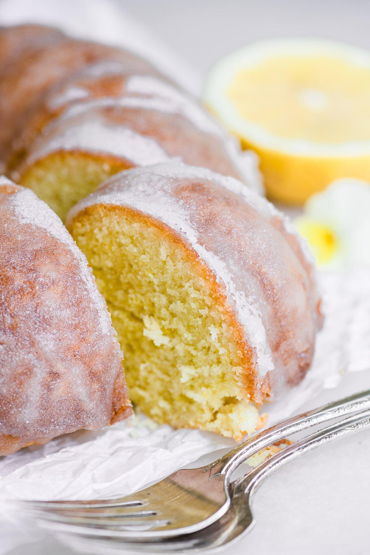 removing a slice of lemon bundt cake
