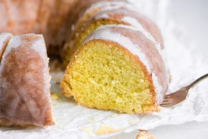 taking a slice of Mary Berry's Lemon Drizzle Cake