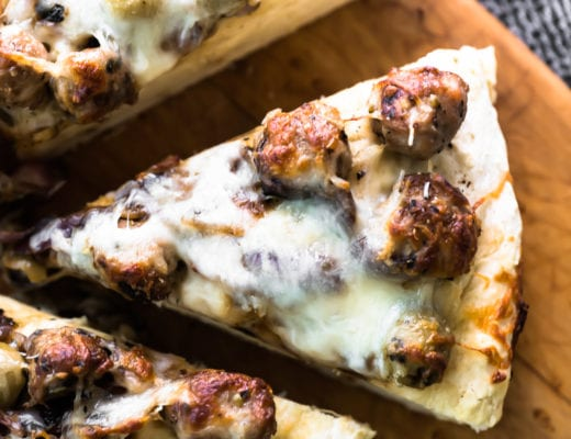 a slice of no yeast pizza with sausage