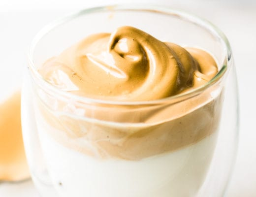 Whipped Coffee in a small glass of milk
