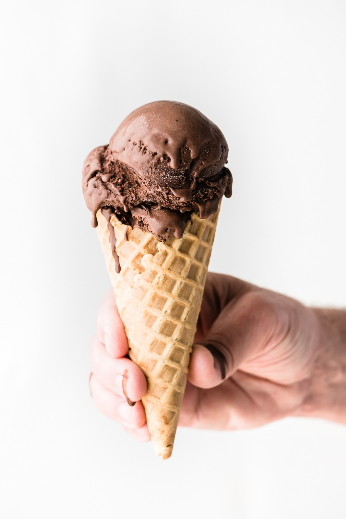 chocolate frozen custard in an ice cream cone