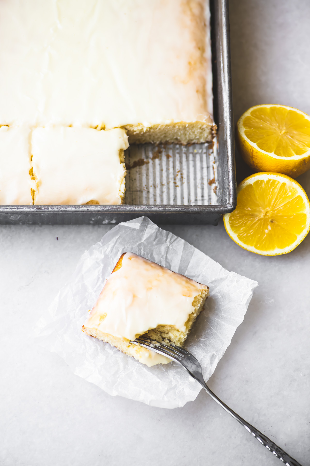 Lemon Velvet Sheet Cake with lemon halves