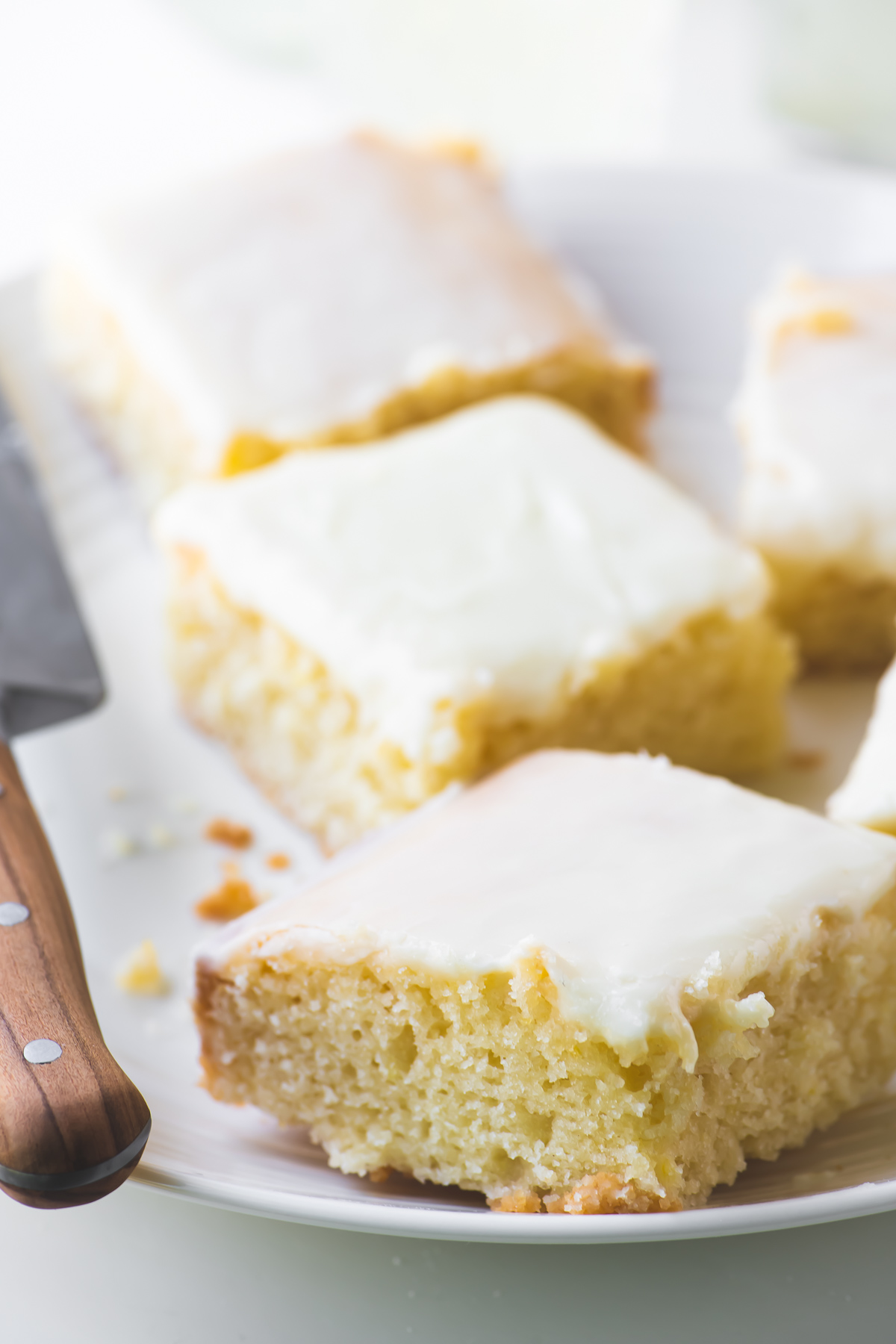 lemon velvet sheet cake squares on a plate