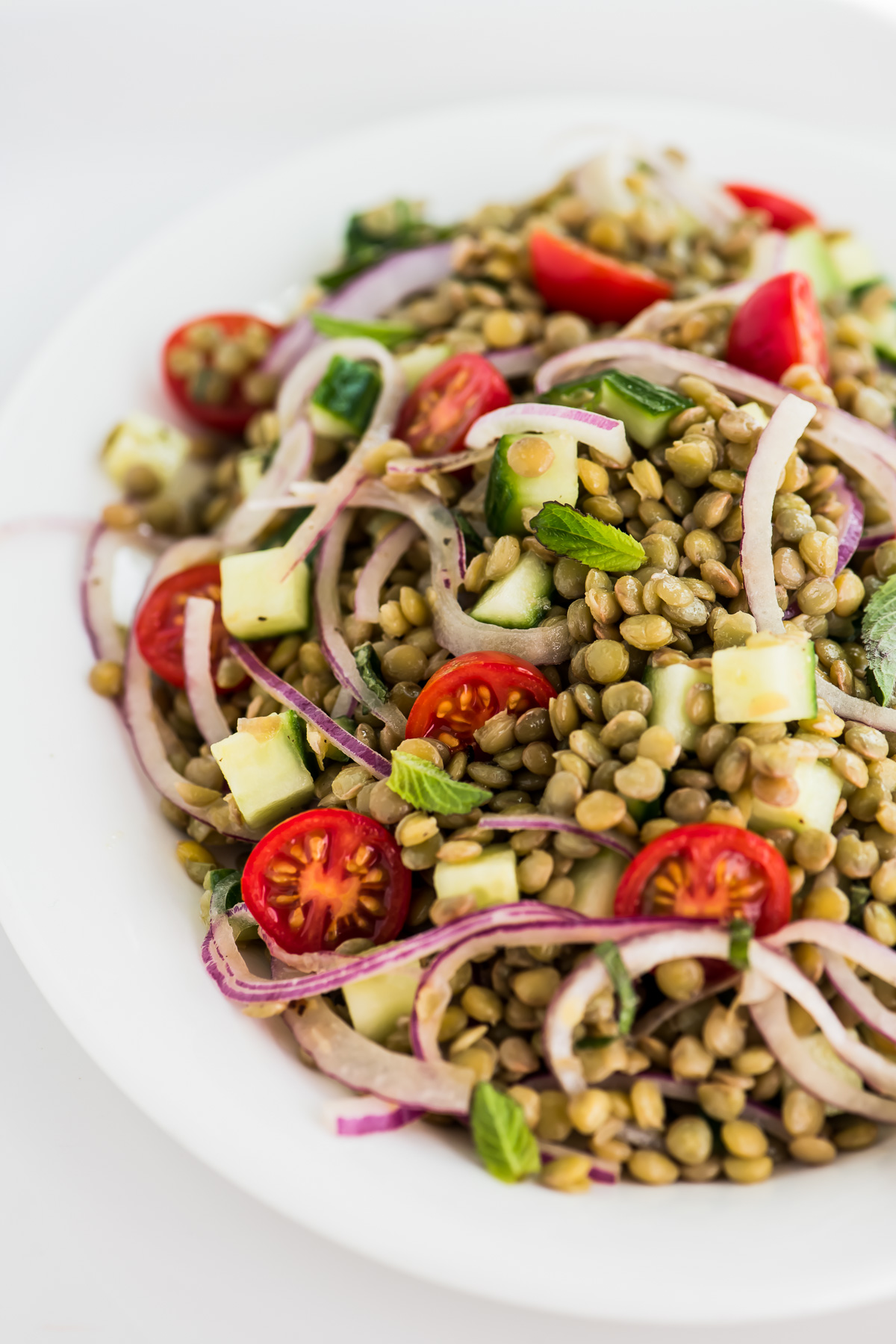 Lentil and cucumber salad with tomatoes and onions