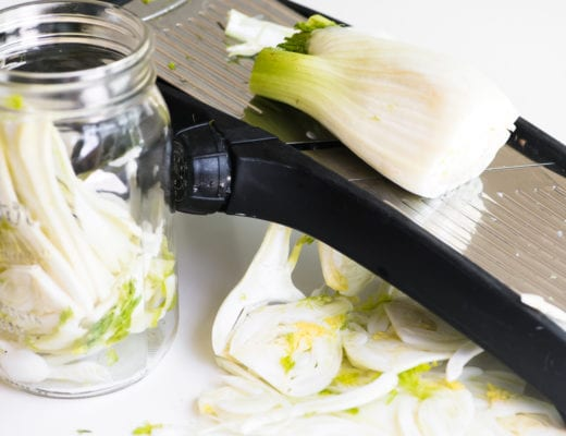slicing fennel on a mandoline slicer
