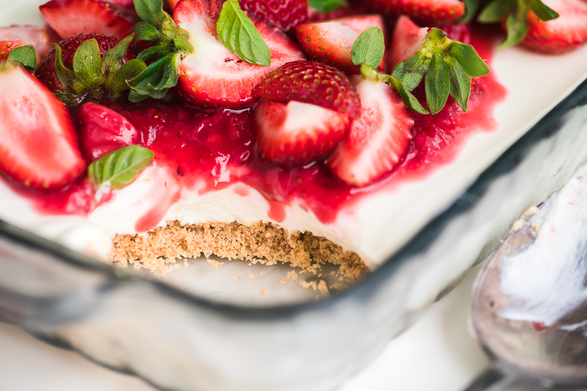 No bake strawberry cheesecake in a glass baking dish
