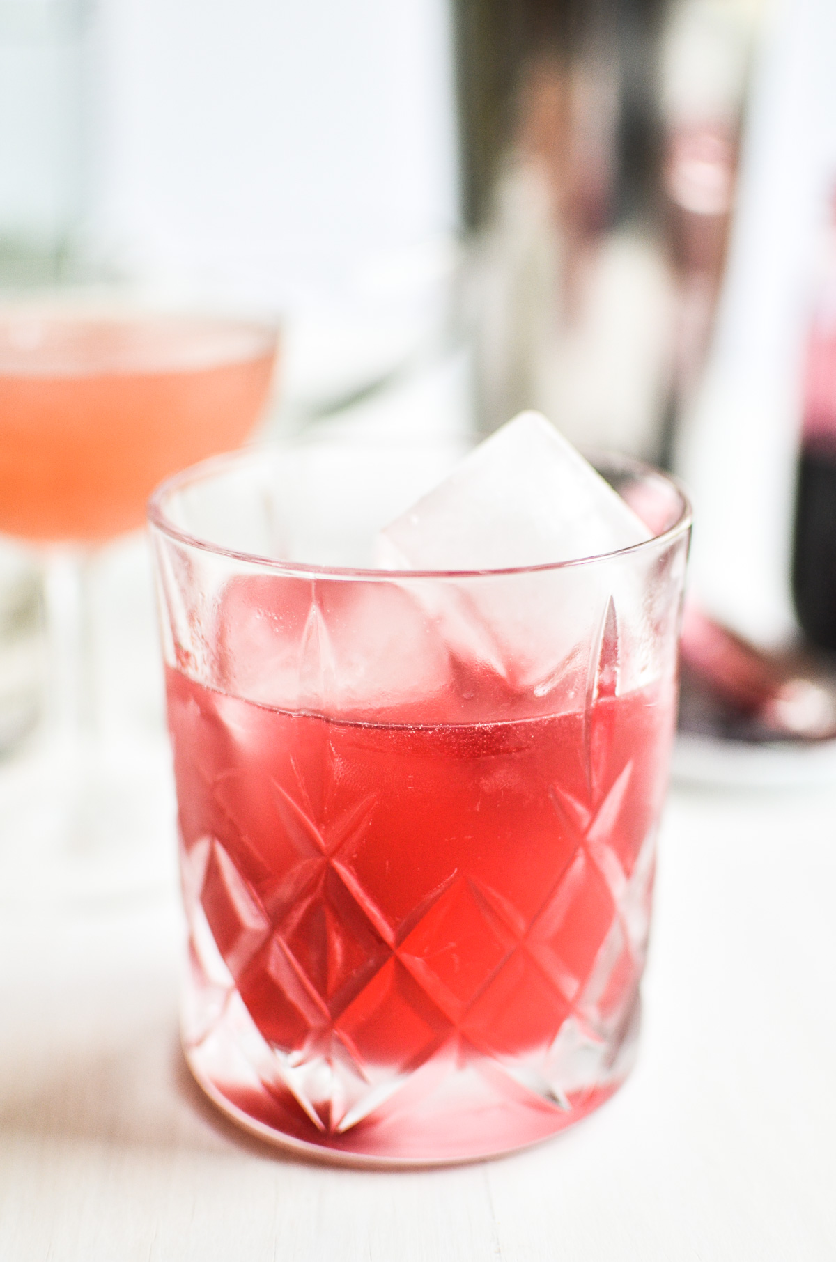 Gin and jam cocktail with ice