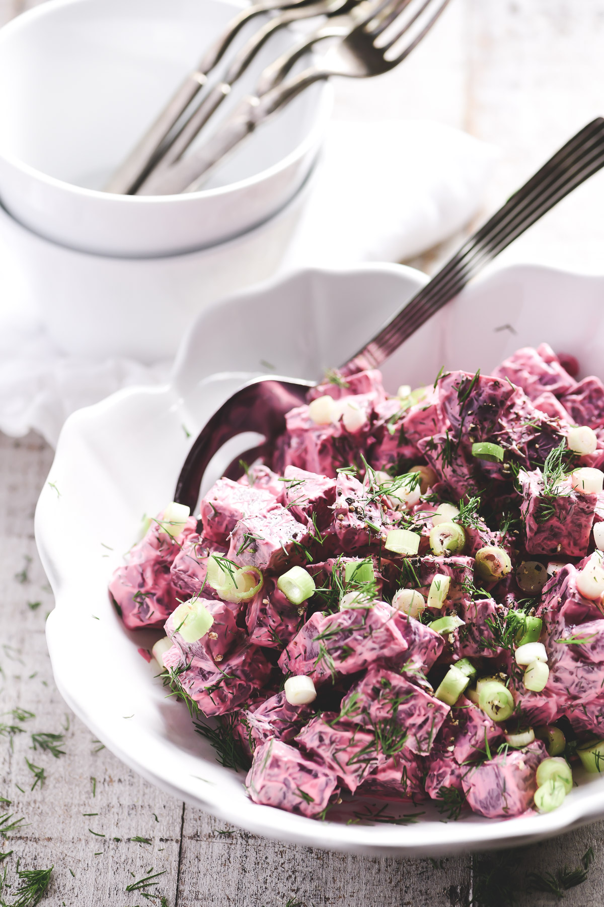 Russian beet salad in a white bowl