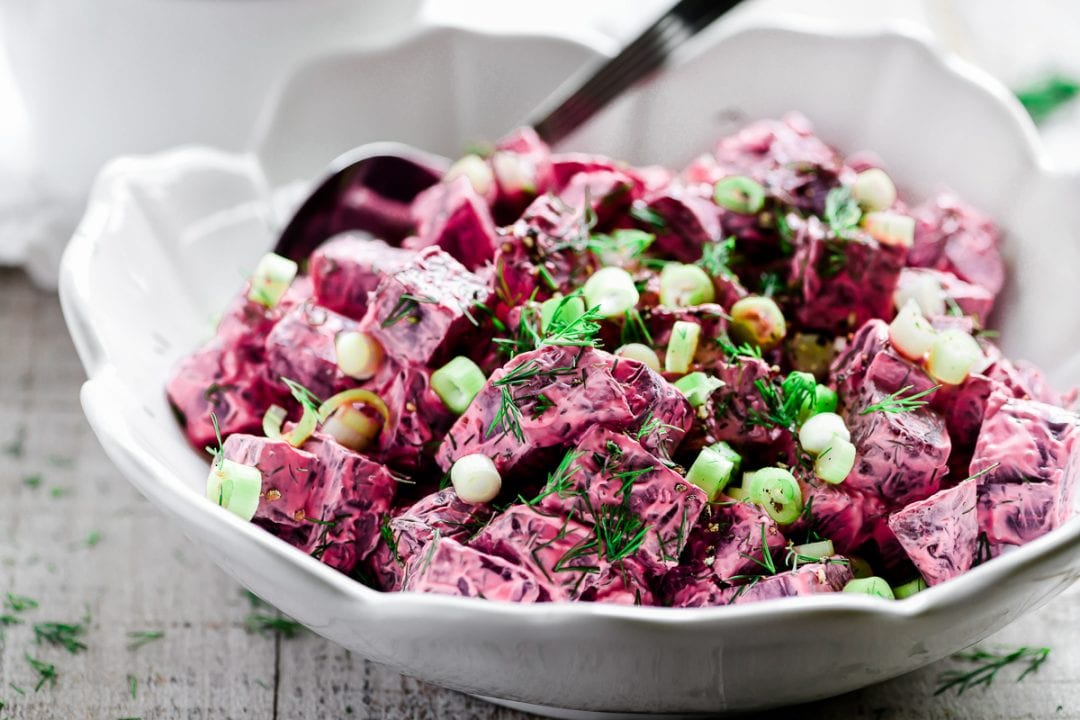 Russian style beet salad in a white bowl