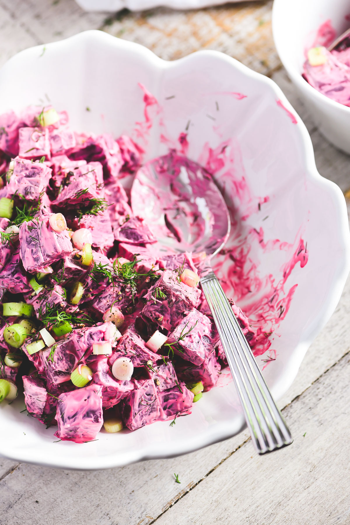 Pretty pink beet salad in a white bowl