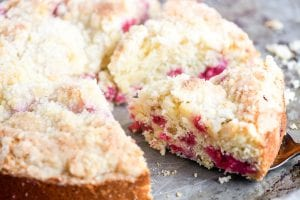 Taking a slice of raspberry coffee cake