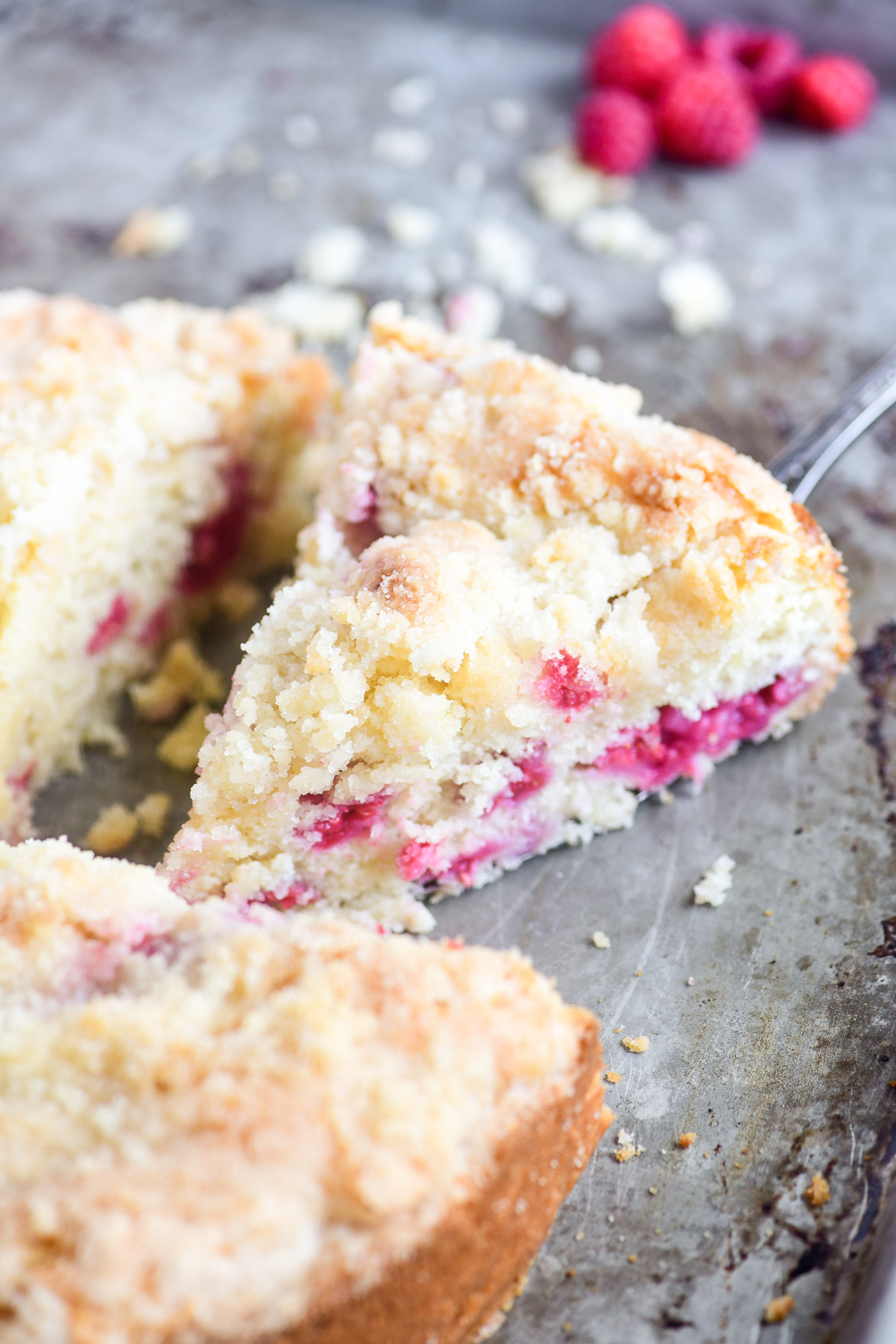 a slice of raspberry coffee cake with streusel topping