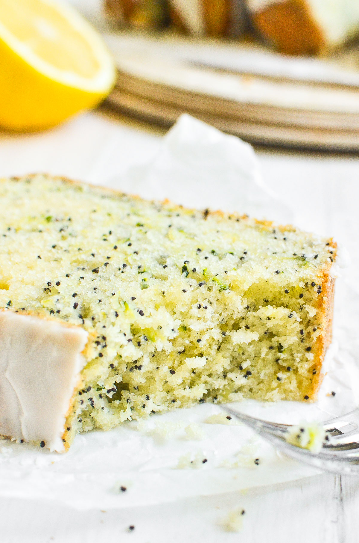 A slice of lemon poppy seed zucchini bread with a fork.