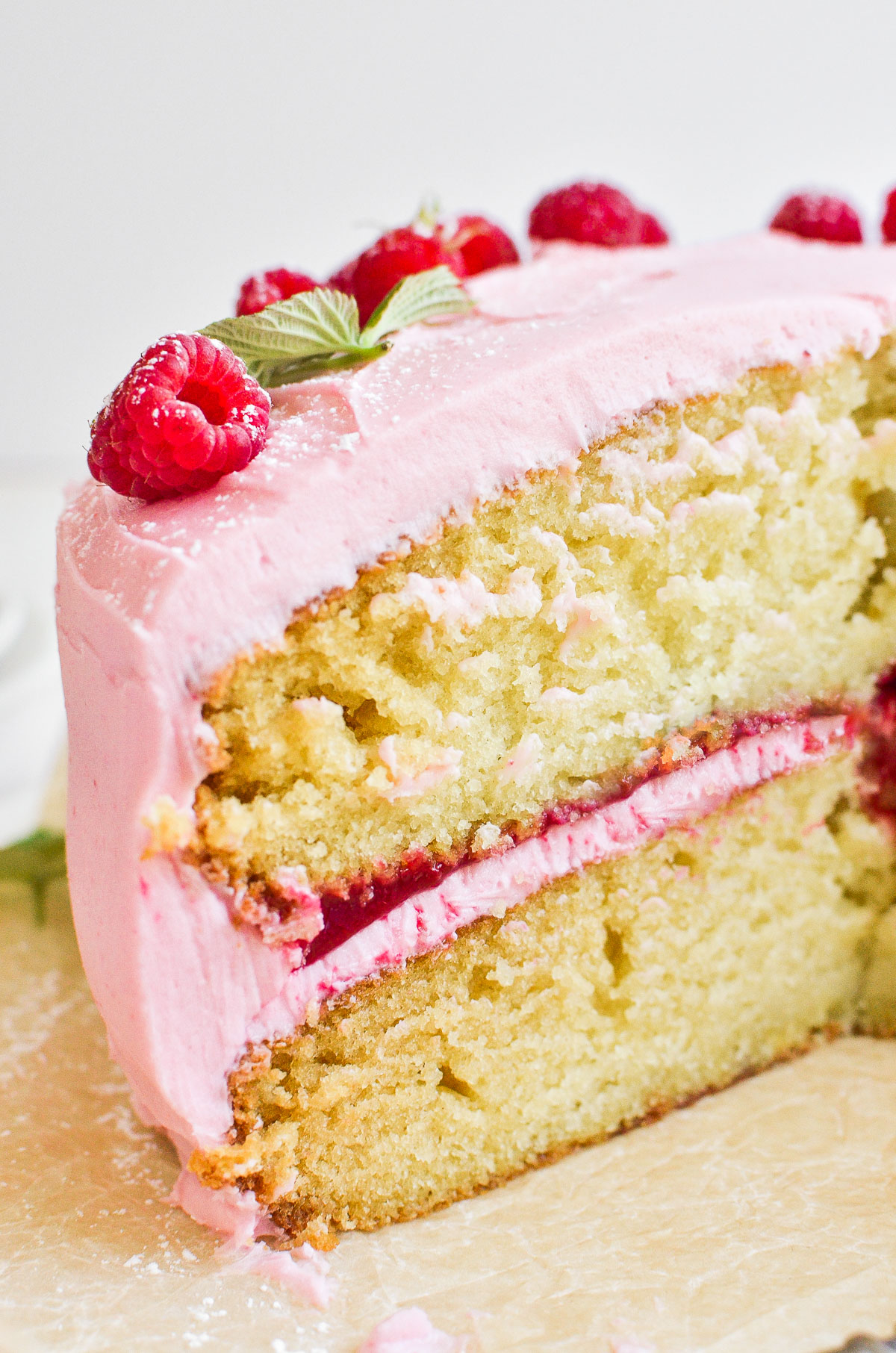 Vanilla cake with raspberry buttercream frosting