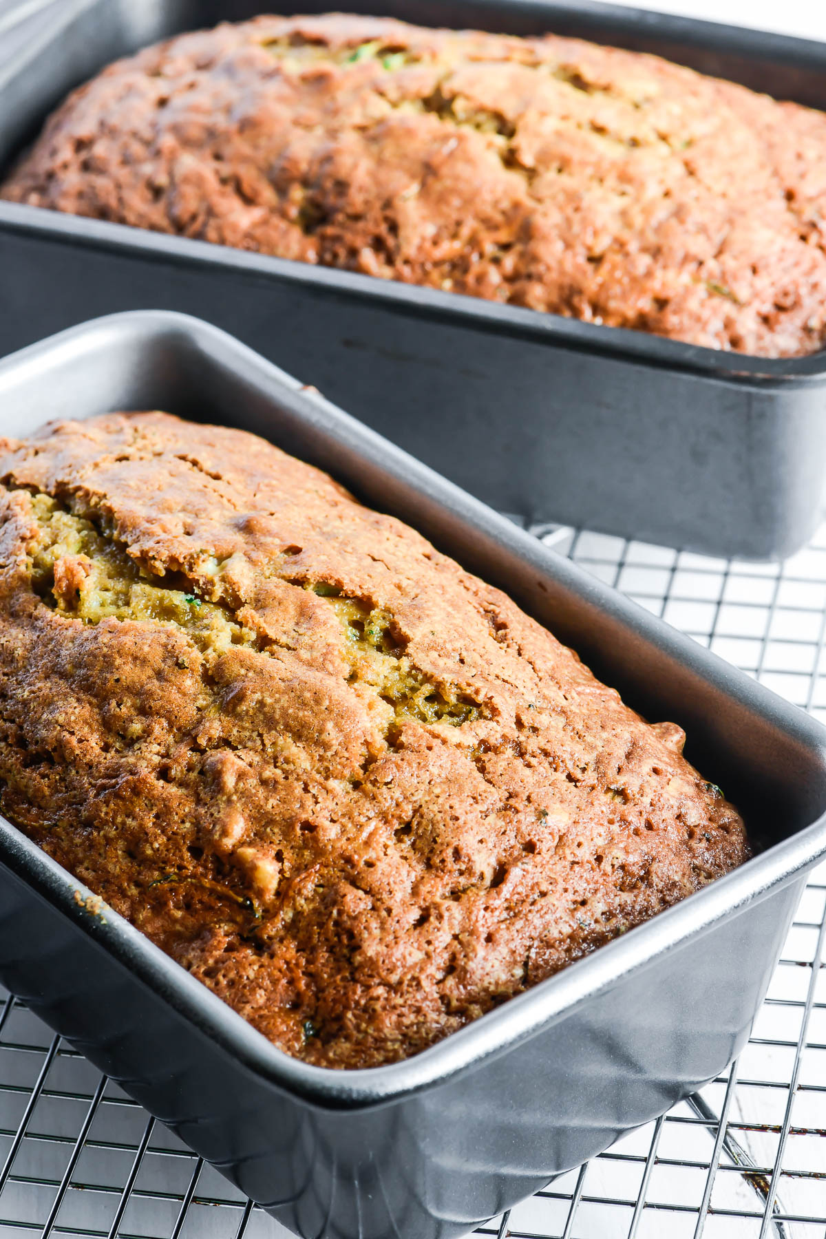 zucchini bread just out of the oven, on a cooling rack