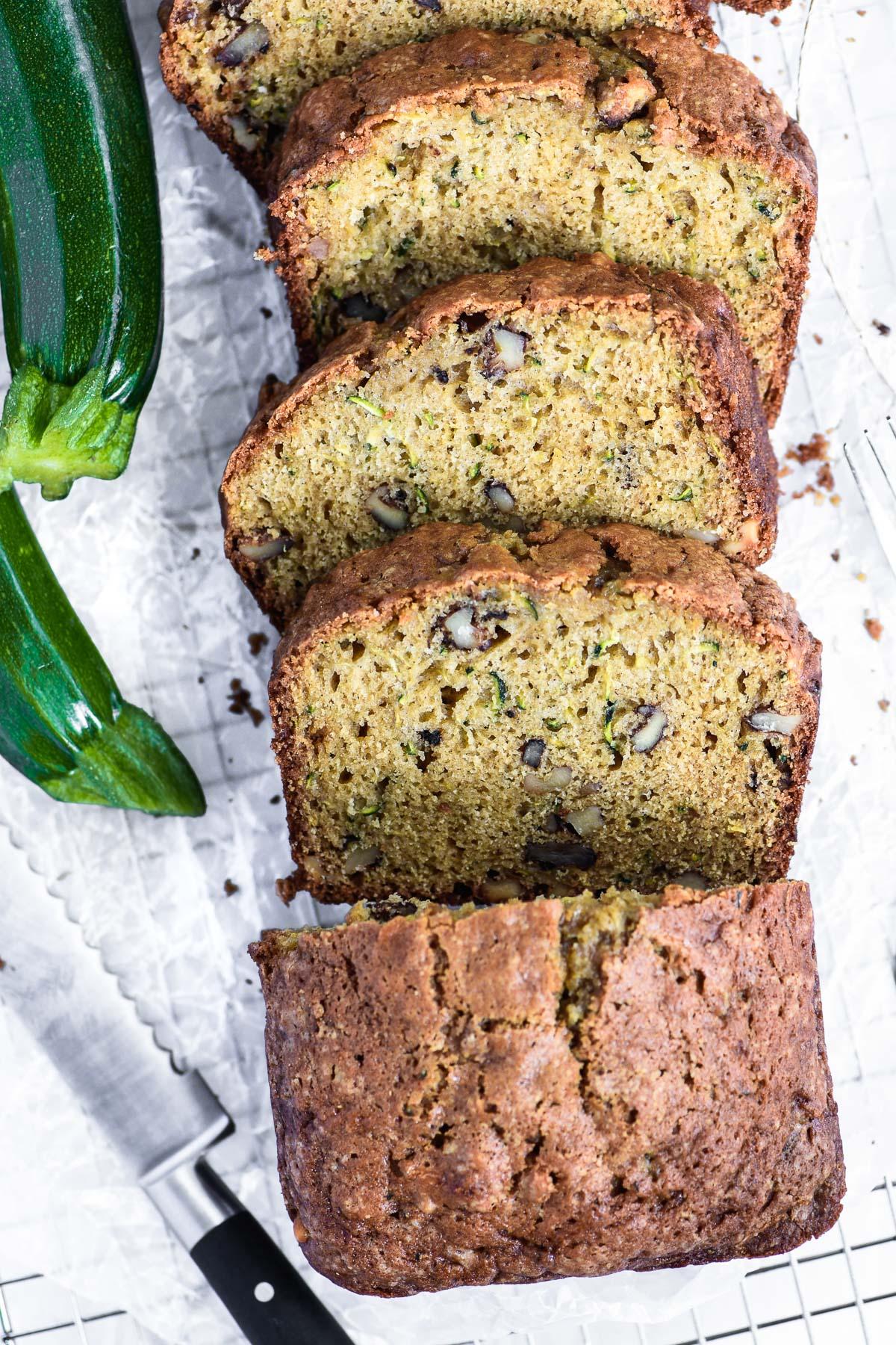 zucchini bread with knife and zucchini