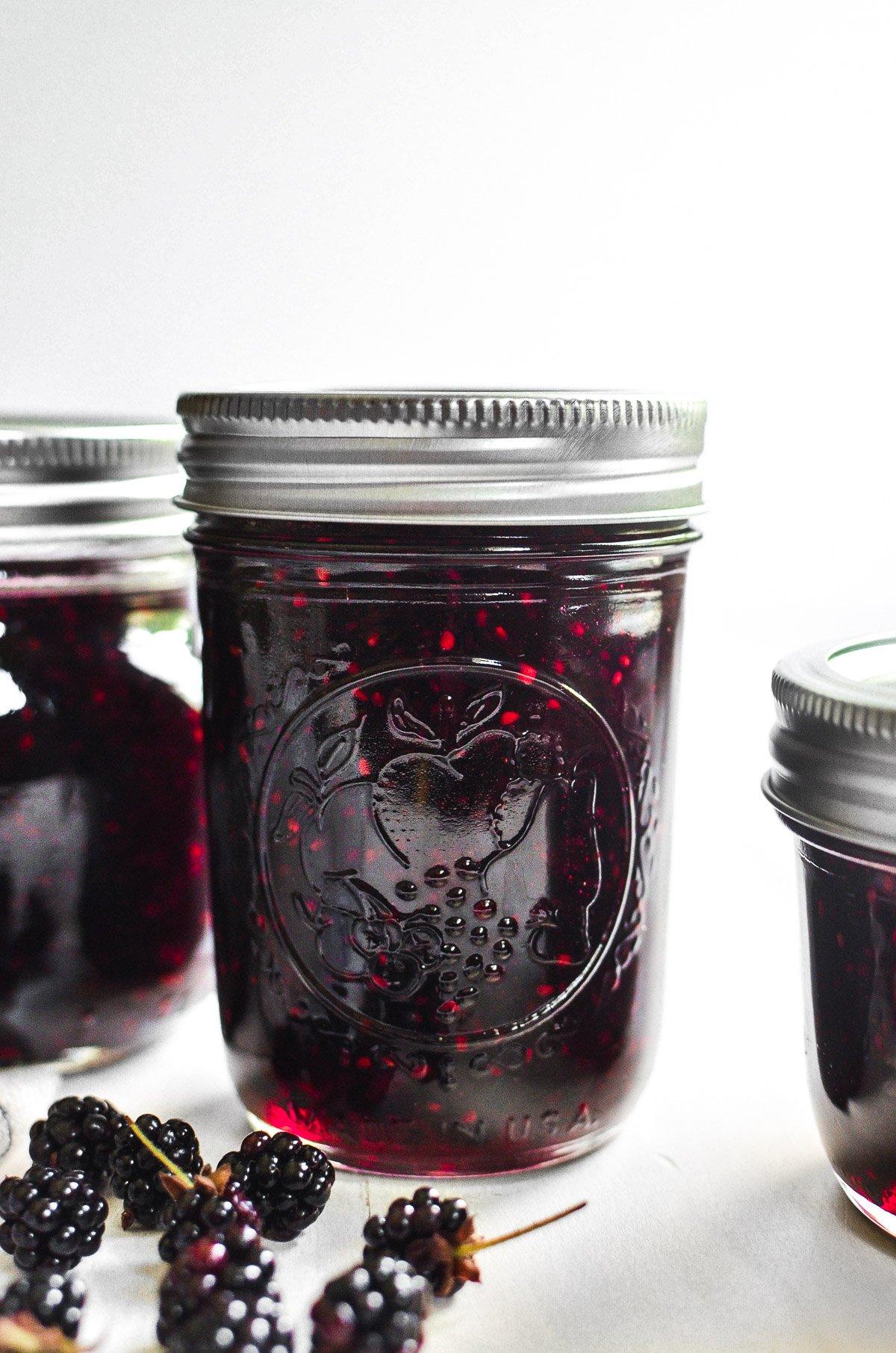 Three jars of blackberry jam.