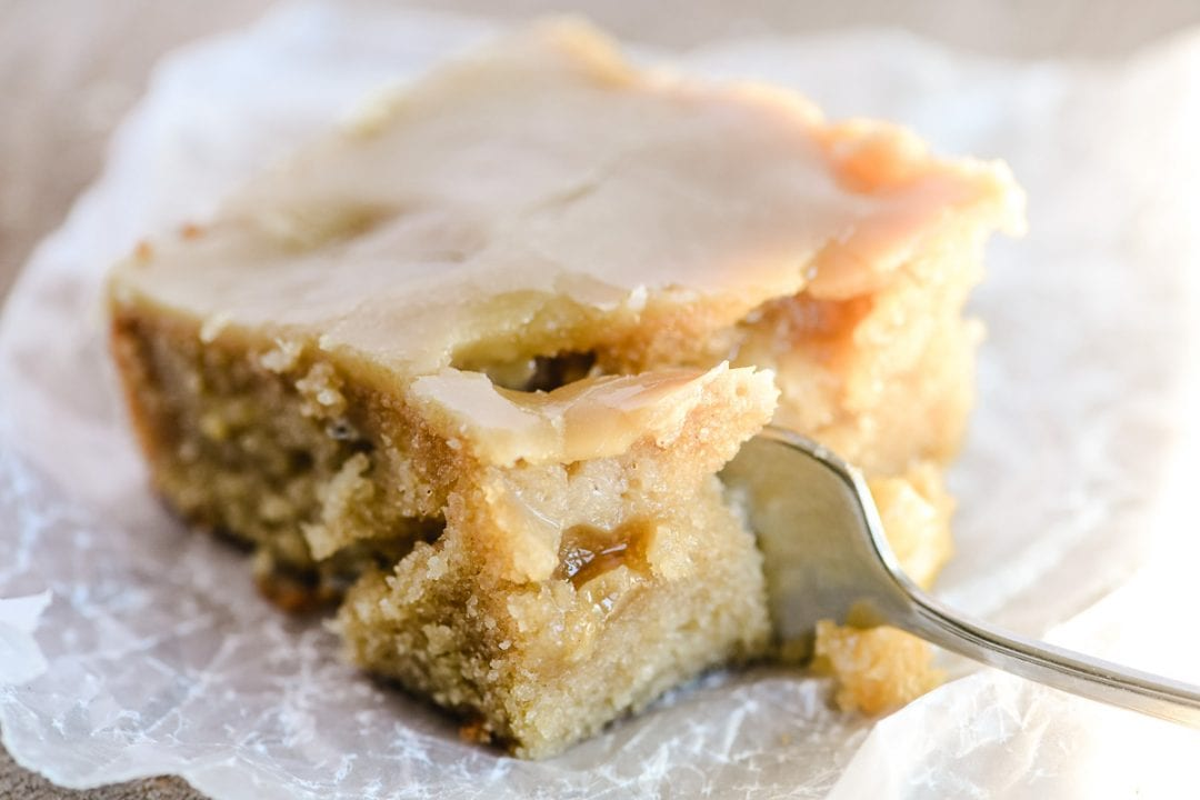 taking a bite of a piece of caramel glazed apple cake