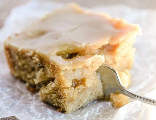 taking a bite of a piece of caramel glazed apple cake