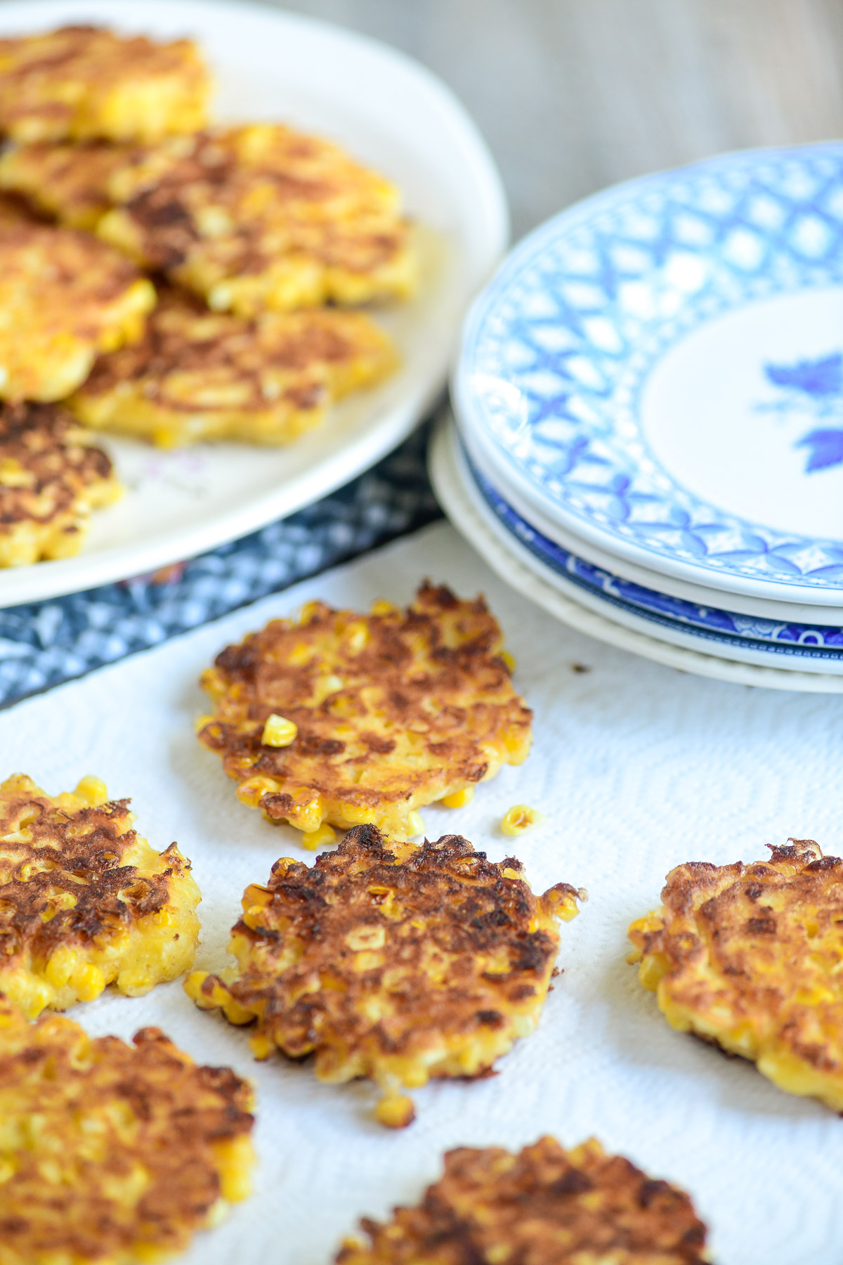 Draining sweet corn fritters on paper towlels