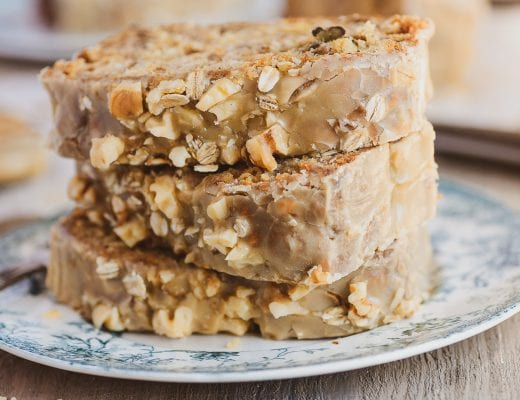 a stack of maple oat nut banana bread slices on a blue plate