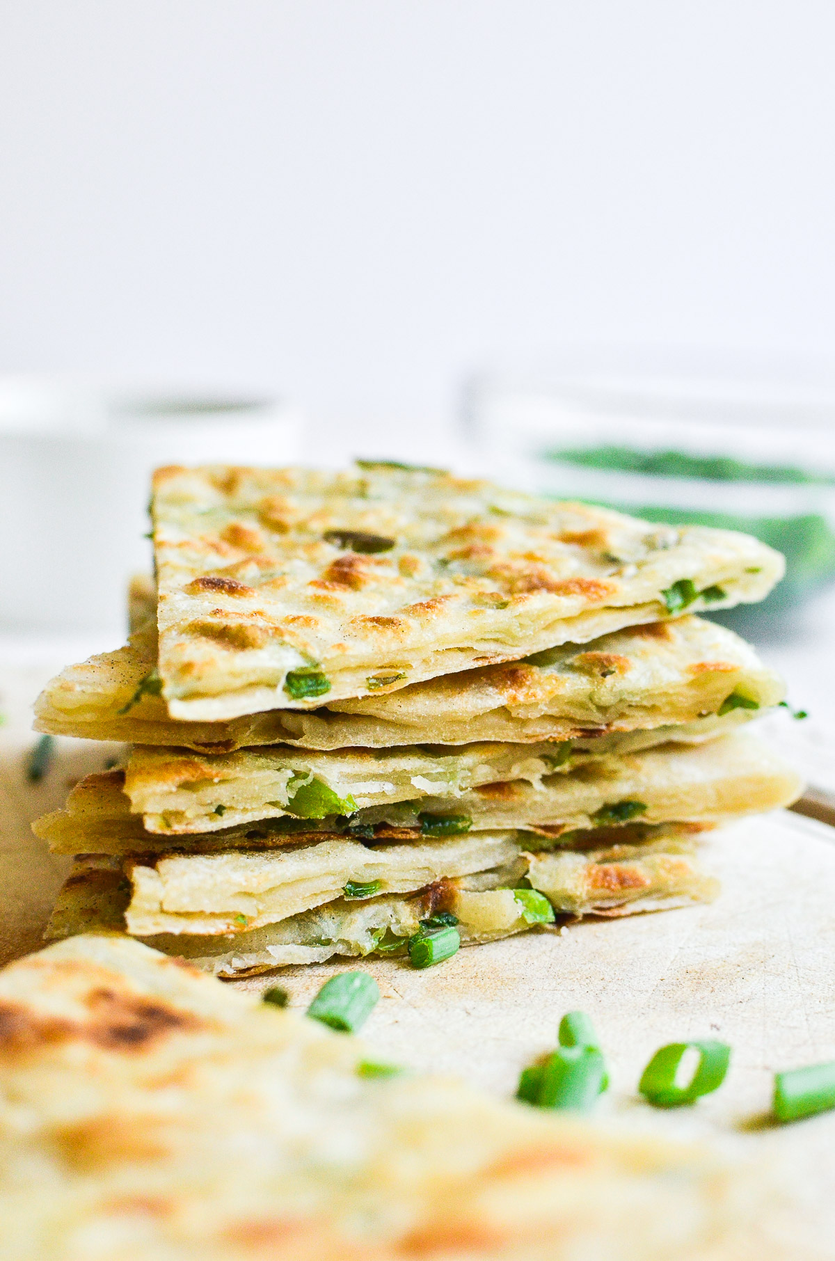 scallion pancakes cut in triangles, stacked
