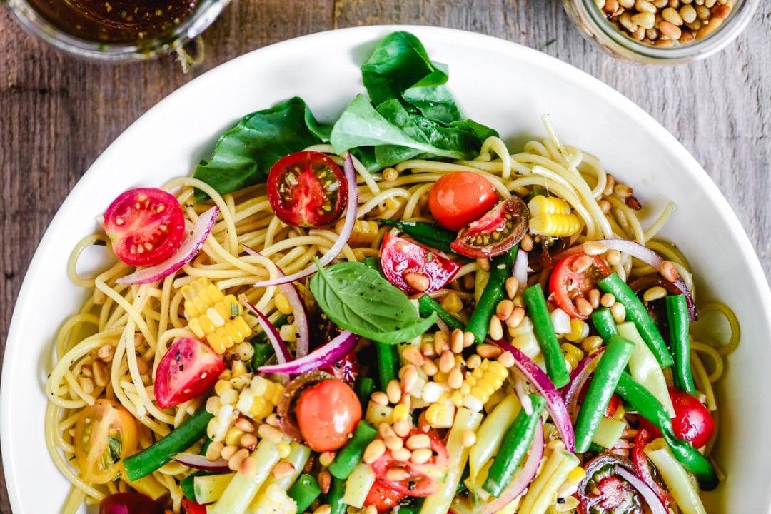 A bowl of spaghetti salad.