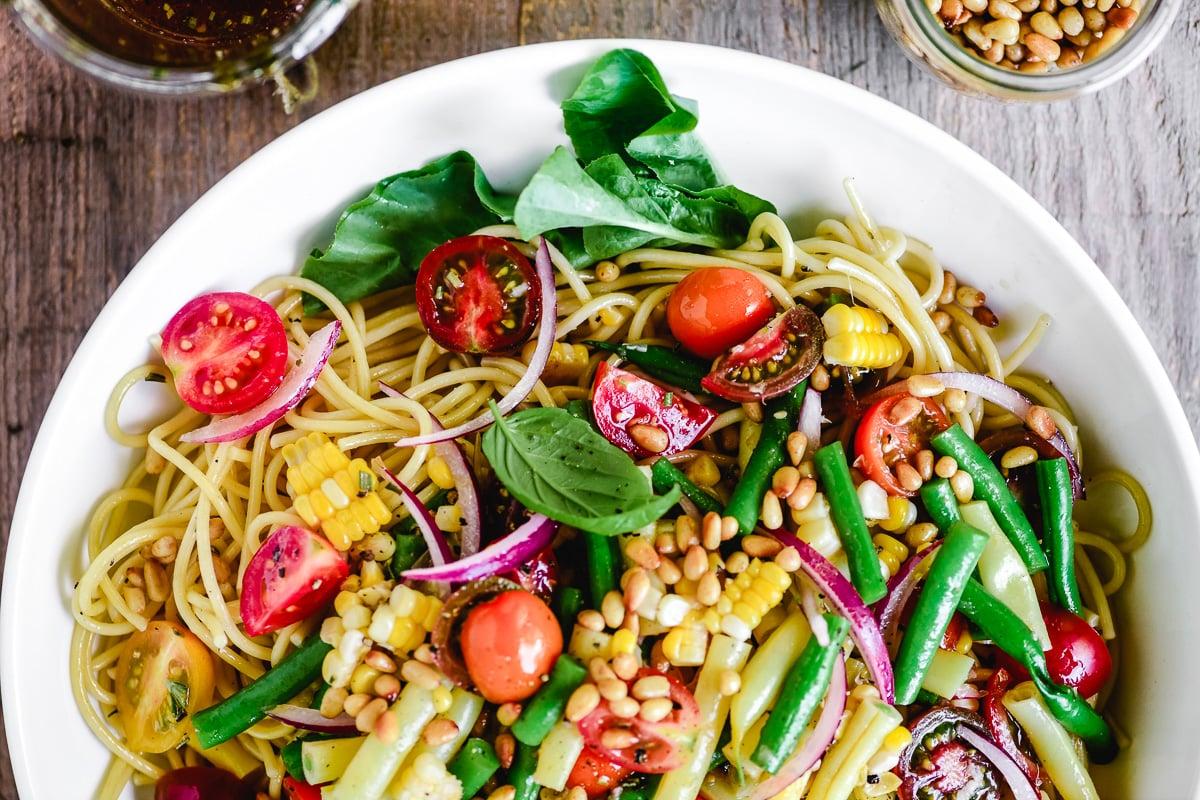 spaghetti salad in a white bowl