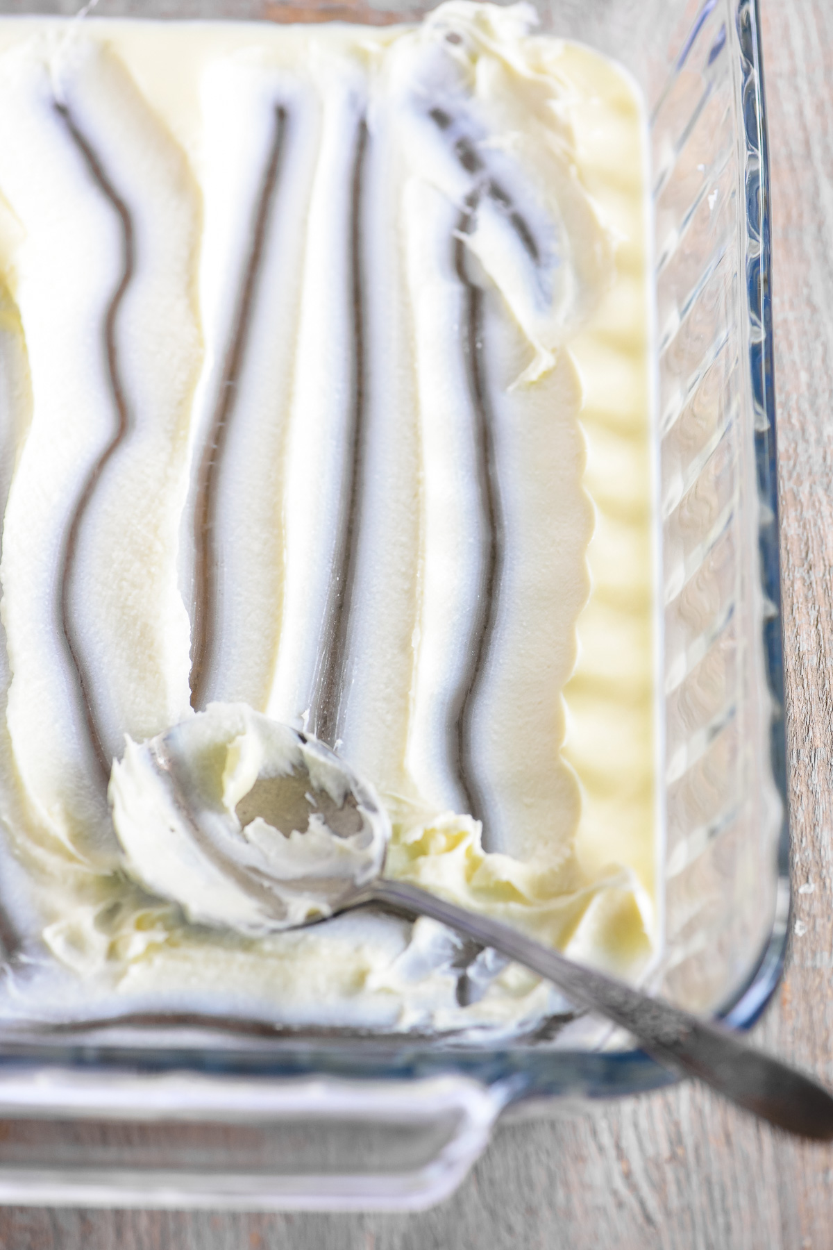 Homemade clotted cream in a glass dish