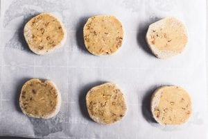 pecan sandies cookies on a baking sheet, ready to bake