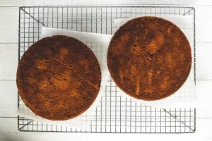 apple butter cake layers cooling on a rack