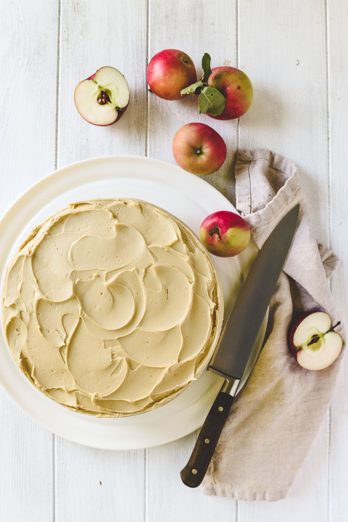 apple butter cake on a platter with apples