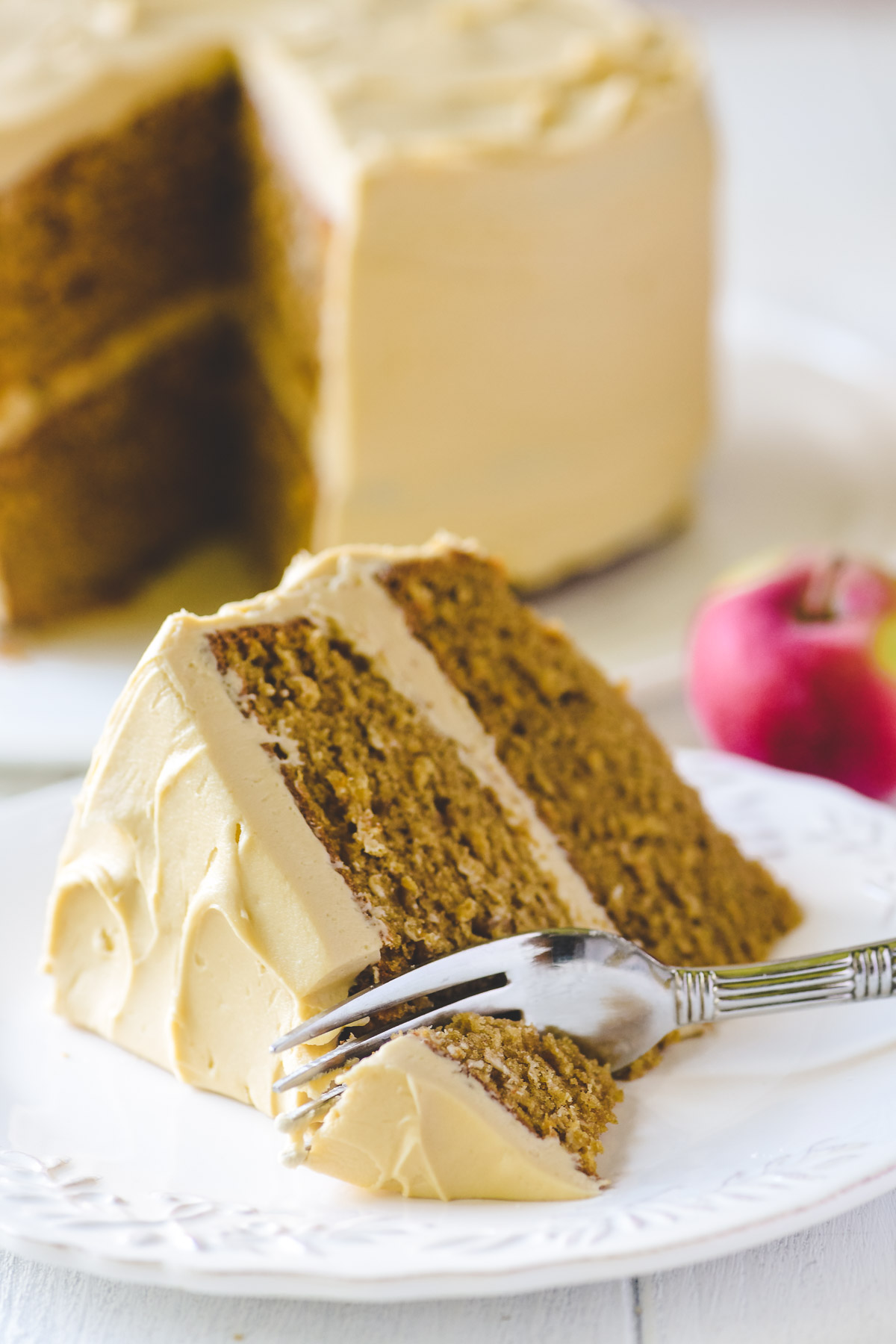 a slice of apple butter cake with fork