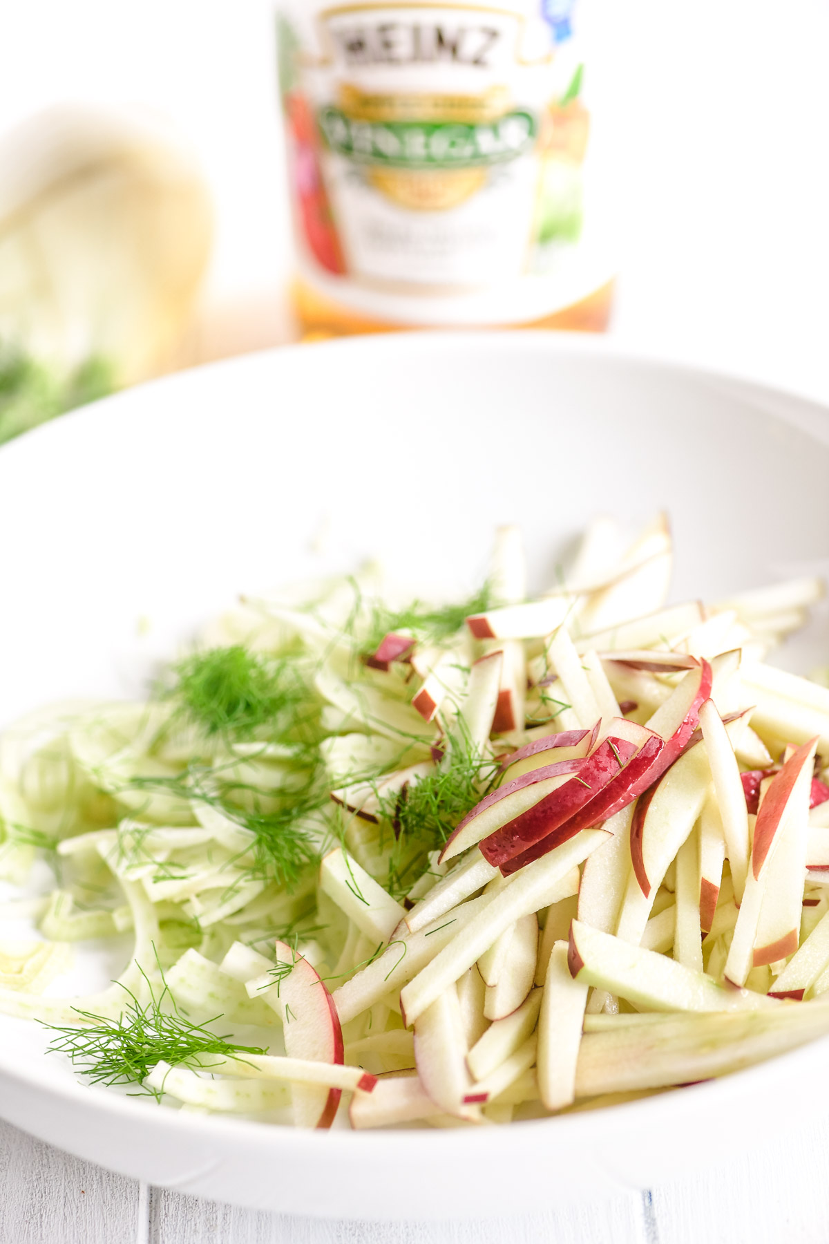 ingredients for an apple, fennel, and salami salad