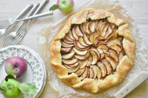 baked apple galette with plate of apples