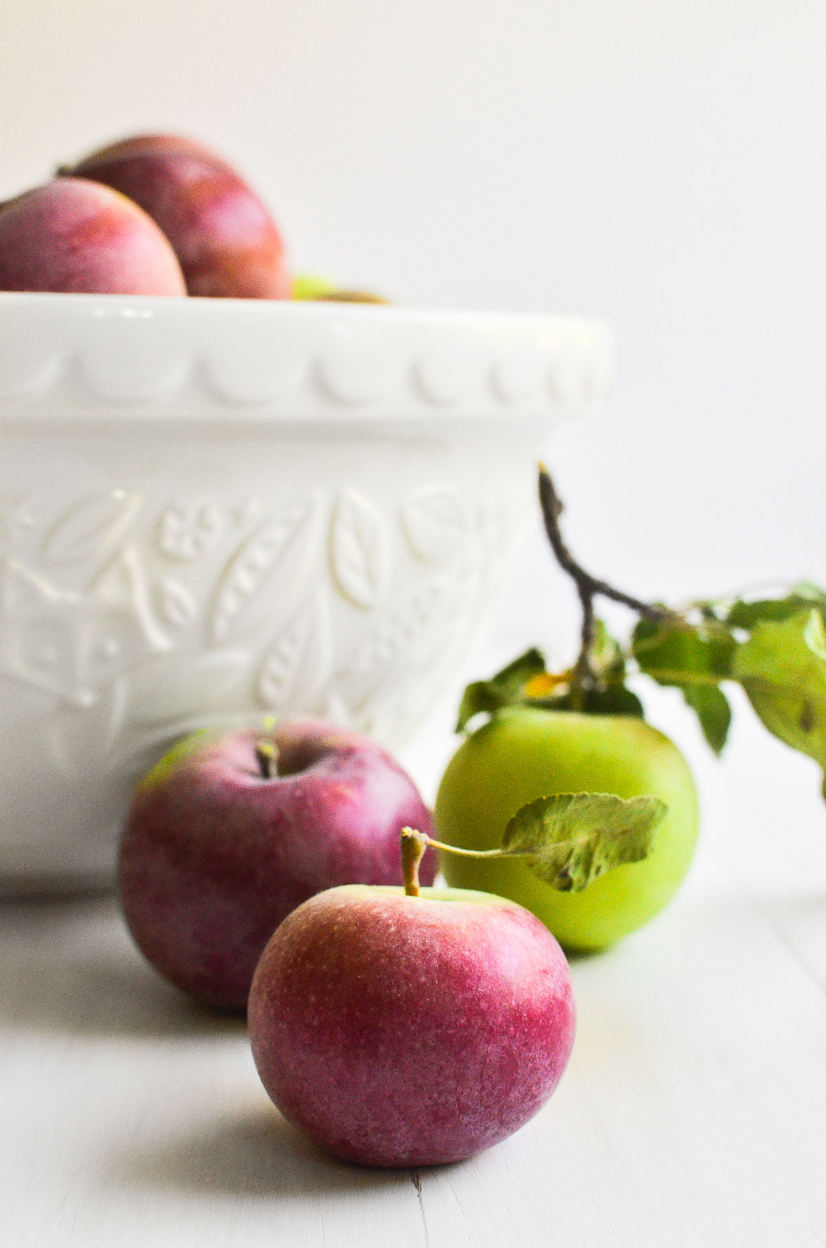 apples with white bowl