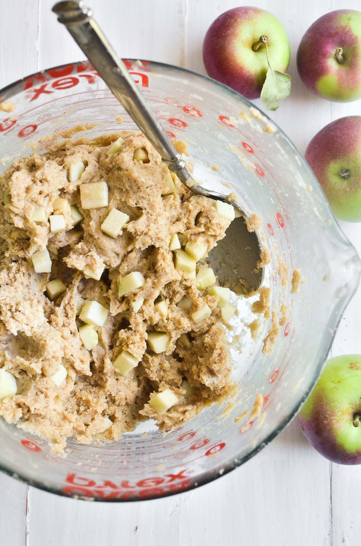 apple pie scone batter in a bowl with spoon